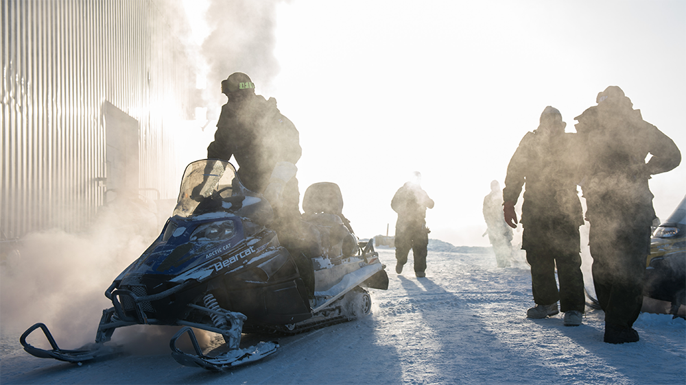 people with snowmobiles