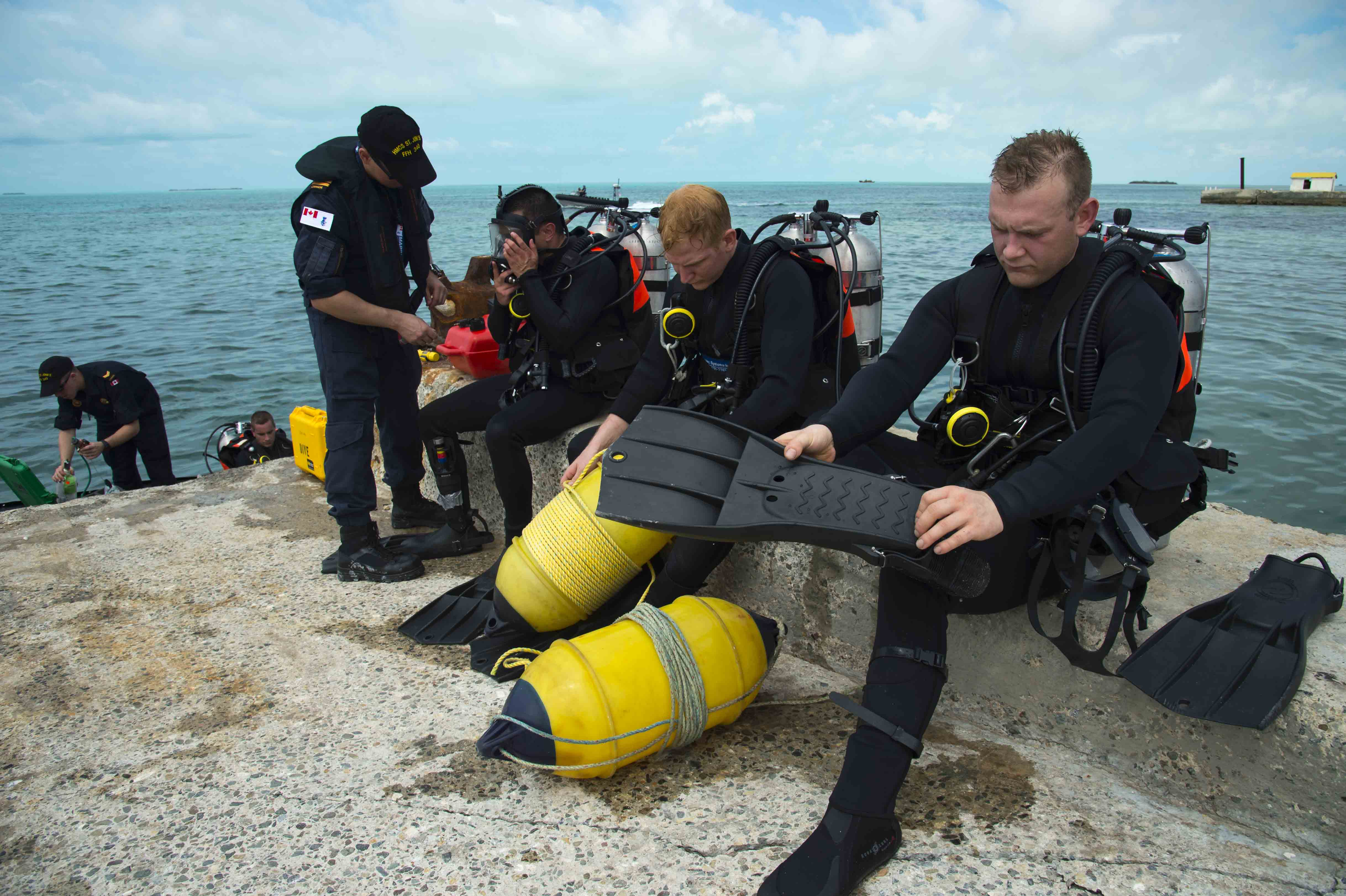 Divers from Her Majesty's Canadian Ship St. John's prepare to inspect a jetty on South Caicos Island during Operation RENAISSANCE, the Hurricane Irma humanitarian aid mission in the Caribbean, on September 17, 2017. Photo: MCpl Chris Ringius, Formation Imaging Services Halifax