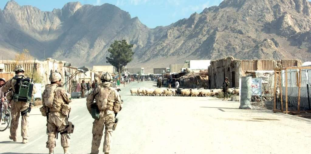 A CIMIC team at work in a village in Afghanistan