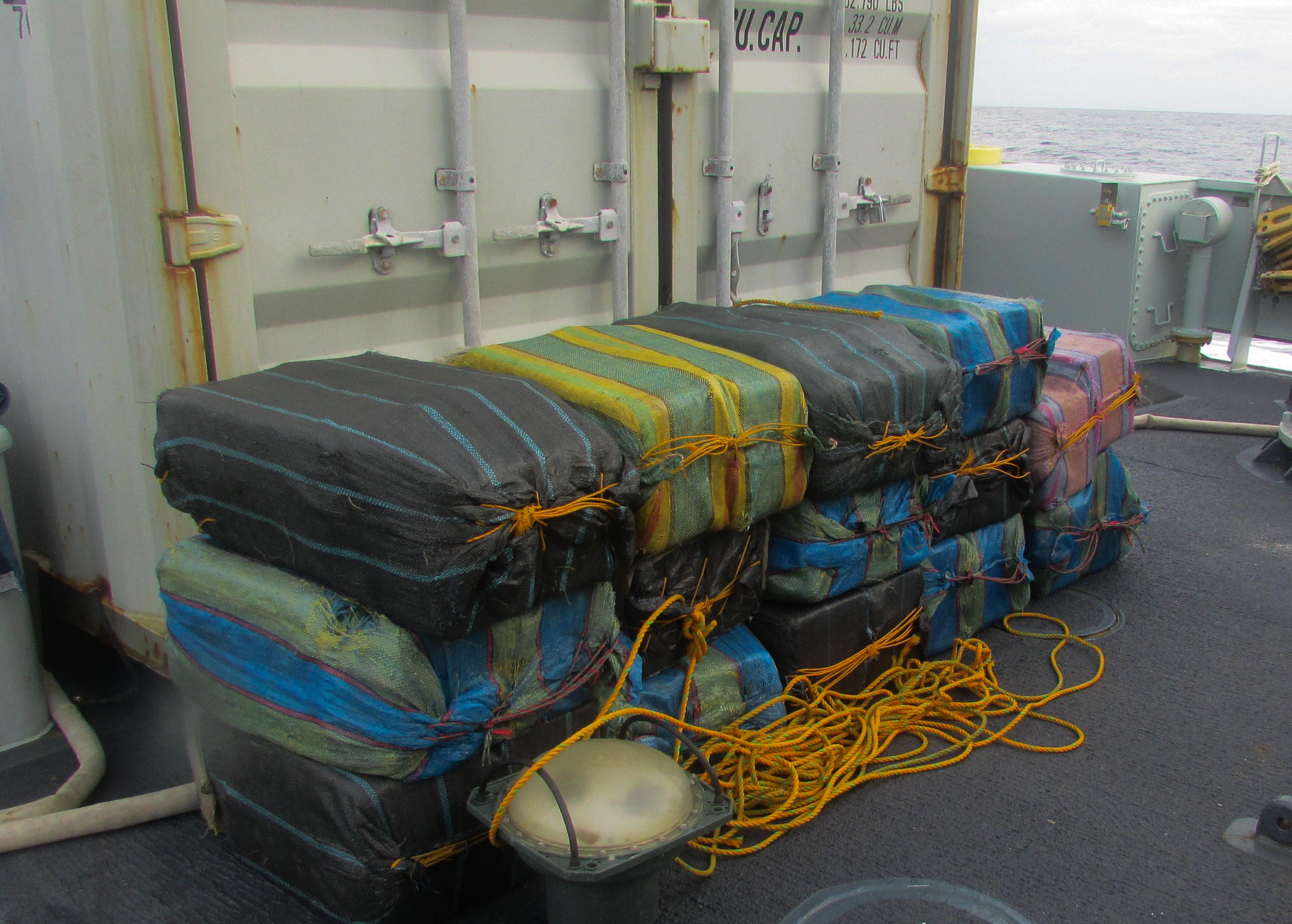 14 bales of cocaine weighing an estimated 700 kg rest on the sweep deck of HMCS BRANDON after being jettisoned by a suspected smuggling vessel, a small fishing boat known as a panga, off the Pacific coast of Central America during Operation CARIBBE on 5 November, 2016. (Image By: U.S. Coast Guard)